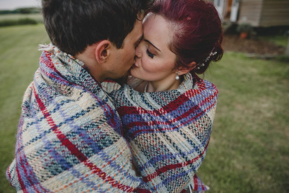 couple kissing under a blanket at godwick