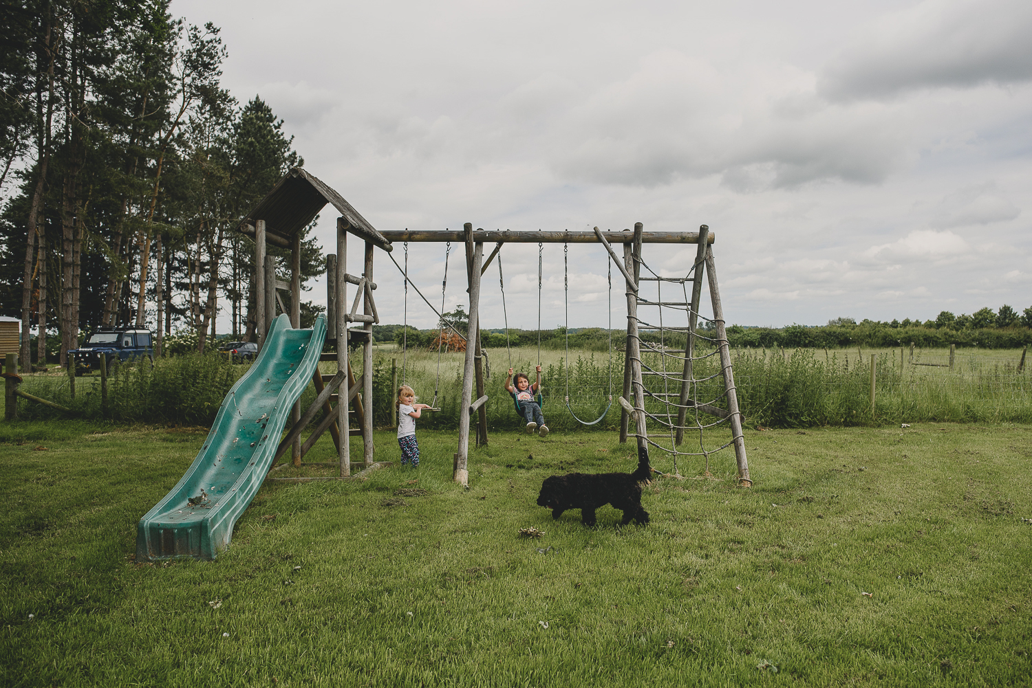 kids playing on swings at godwick