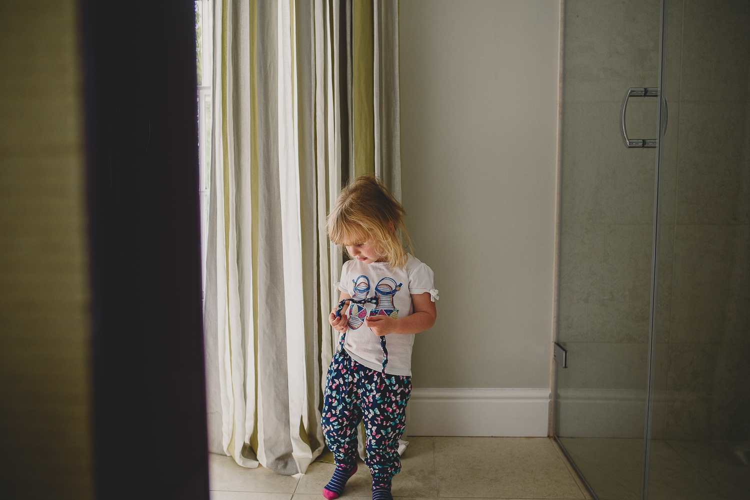 kid standing by the window