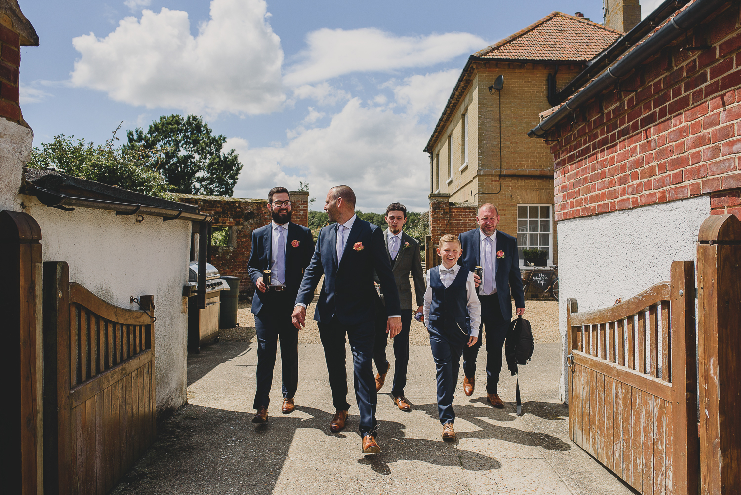 groomsmen walking away to ceremony