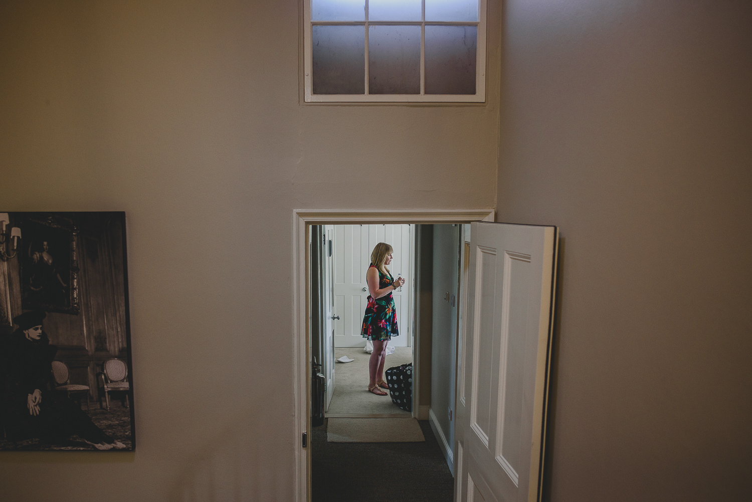 wedding guest standing in hallway at godwick