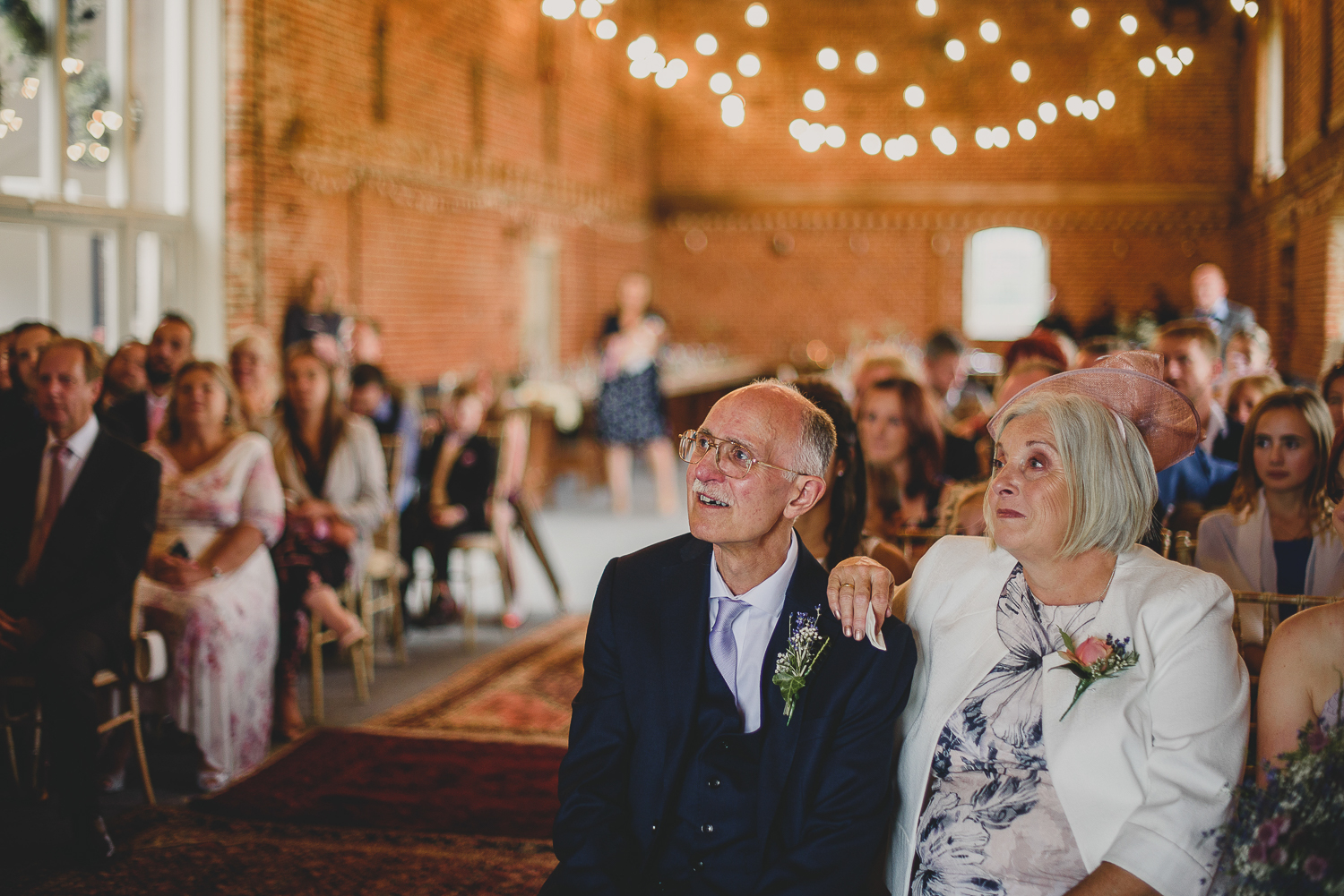 parents of bride watch on during ceremony