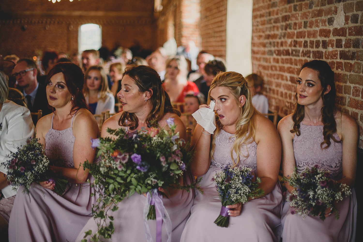 bridesmaids cry during ceremony at godwick