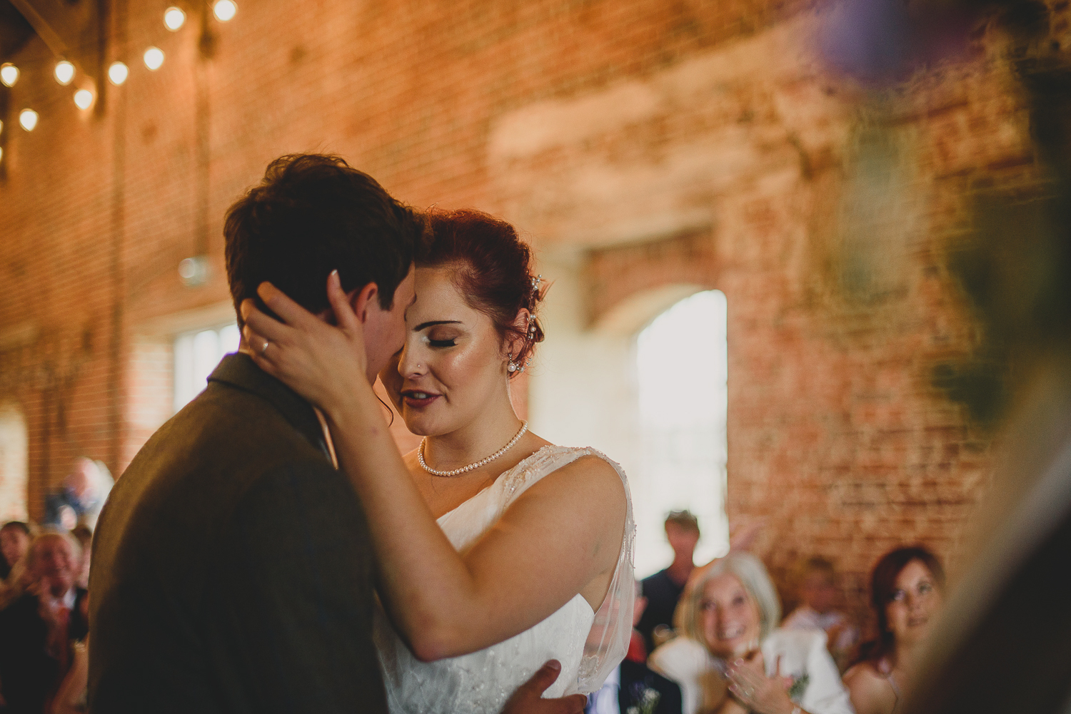 couple hold each other close during ceremony