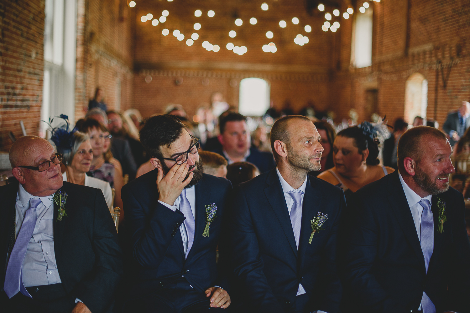 groomsmen cry during ceremony at godwick