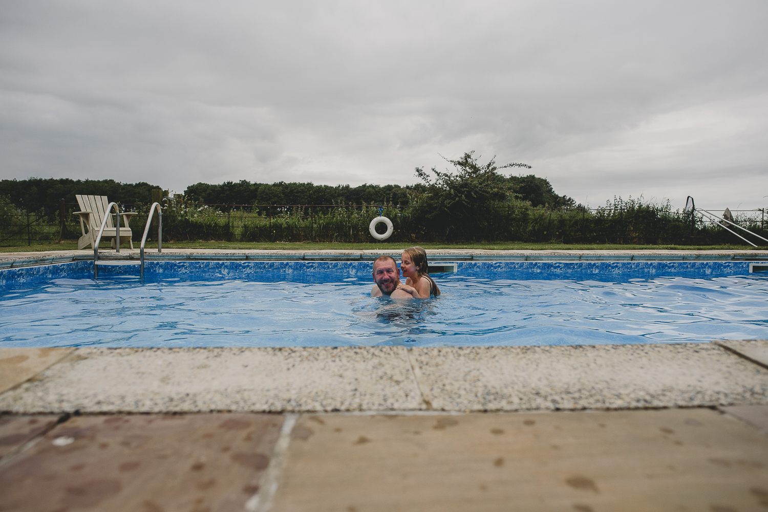 guests playing in pool at godwick