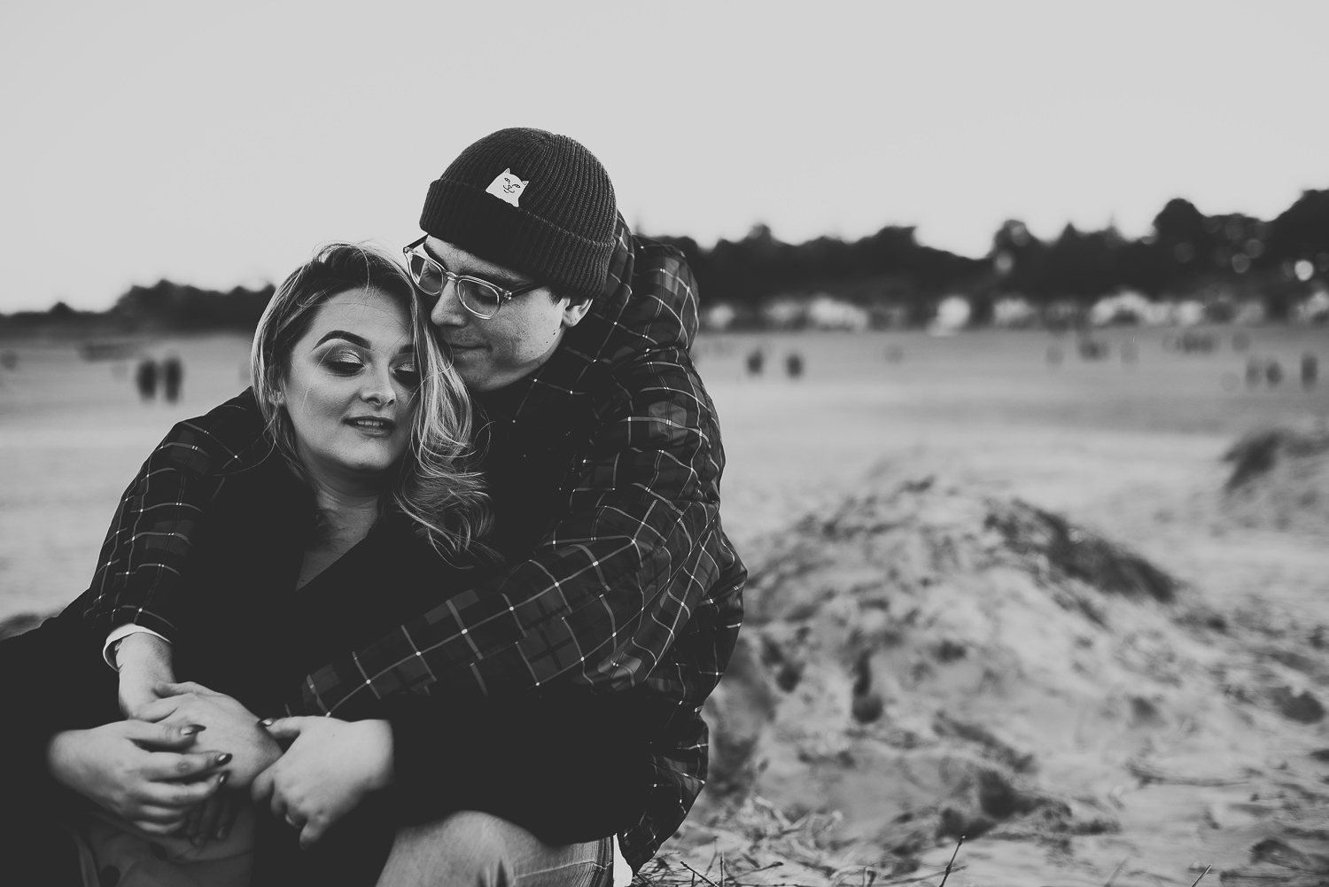 black and white images of couple hugging on wells beach
