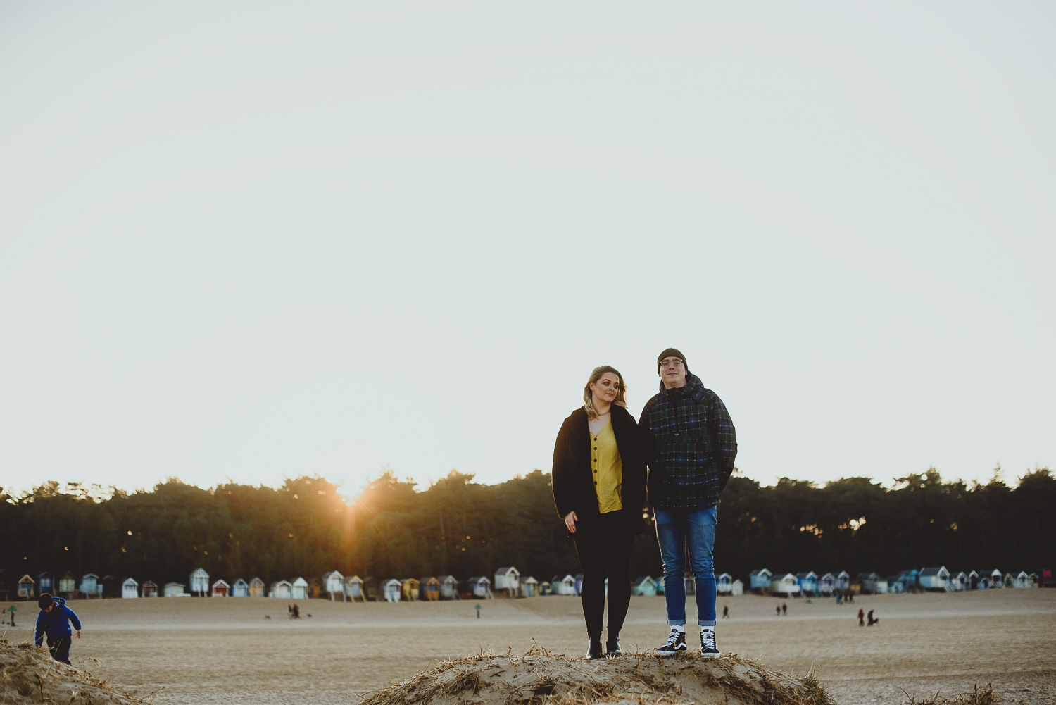 couple standing on sand dunes at wells