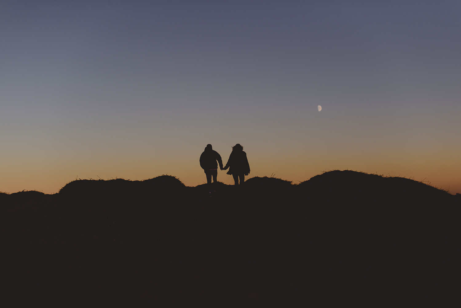 silhouette of couple at wells beach