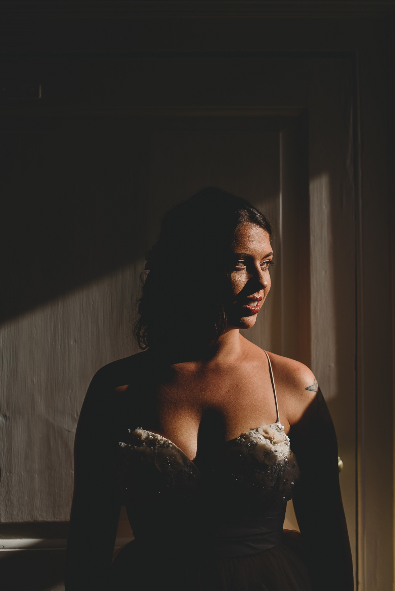bride in window light at college farm