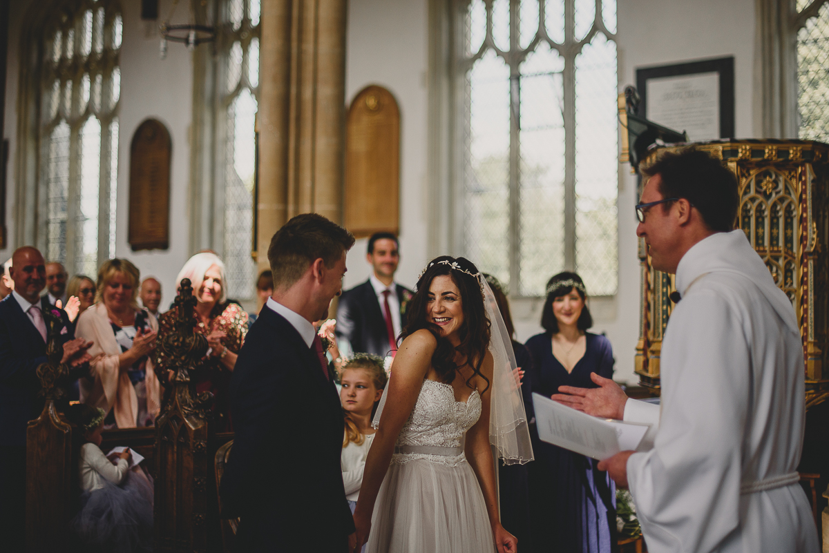 bride excited to see groom at southwold church