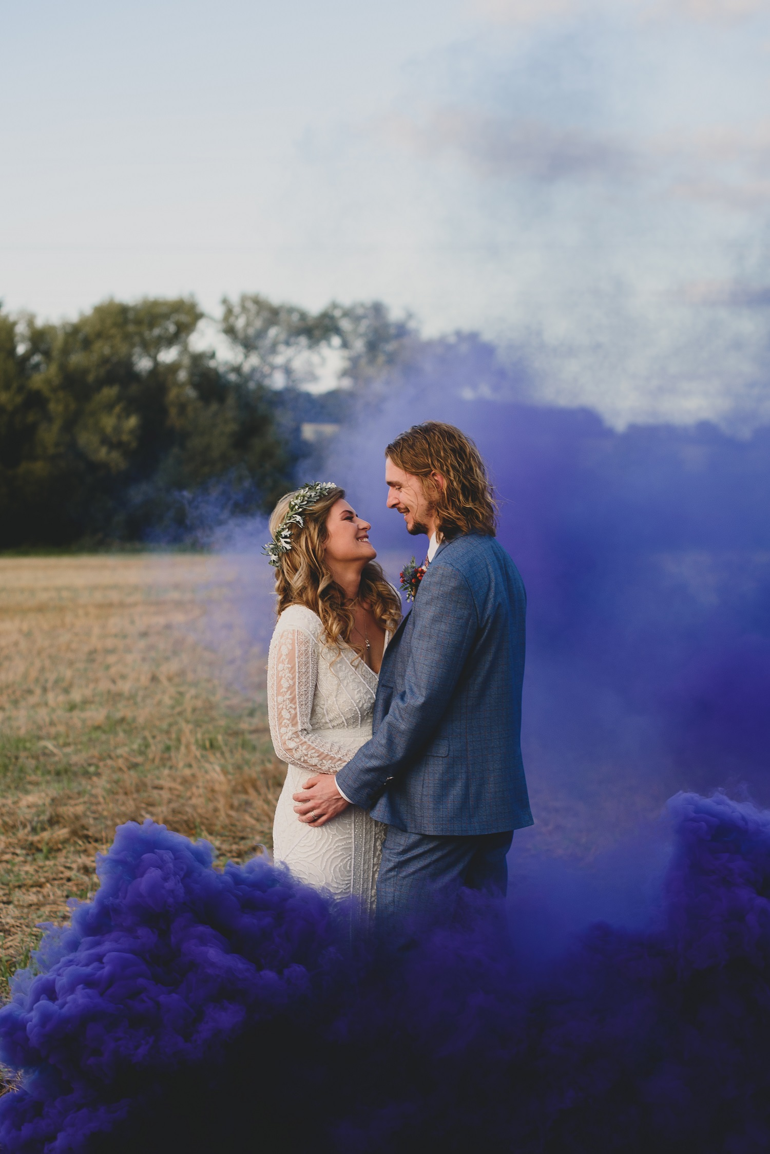 couple in purple smoke bomb