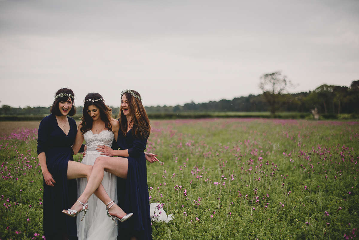 bridesmaids showing leg at wood farm barn