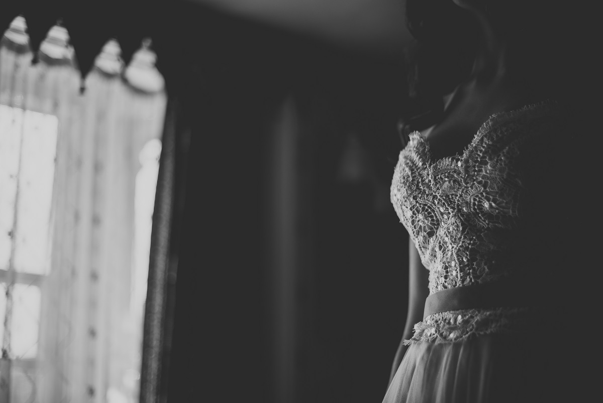 bride's dress in window light