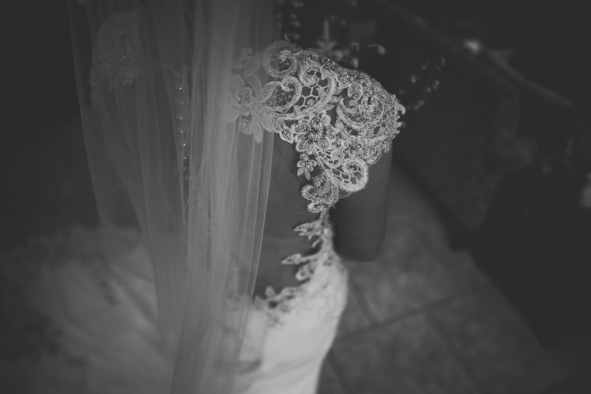 detail close up of brides wedding dress