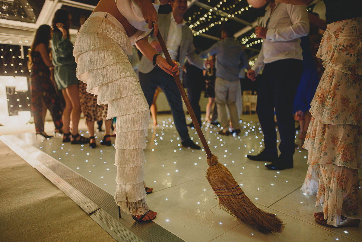 wedding guest dancing with broomstick
