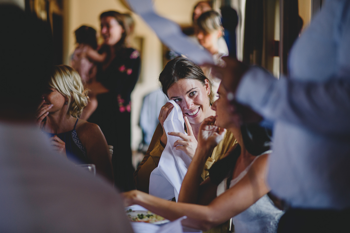 bridesmaid wiping tears during speech at voewood