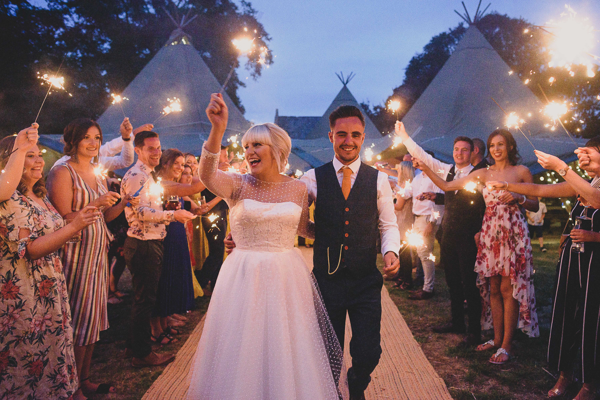 couple during sparkler exit at college farm