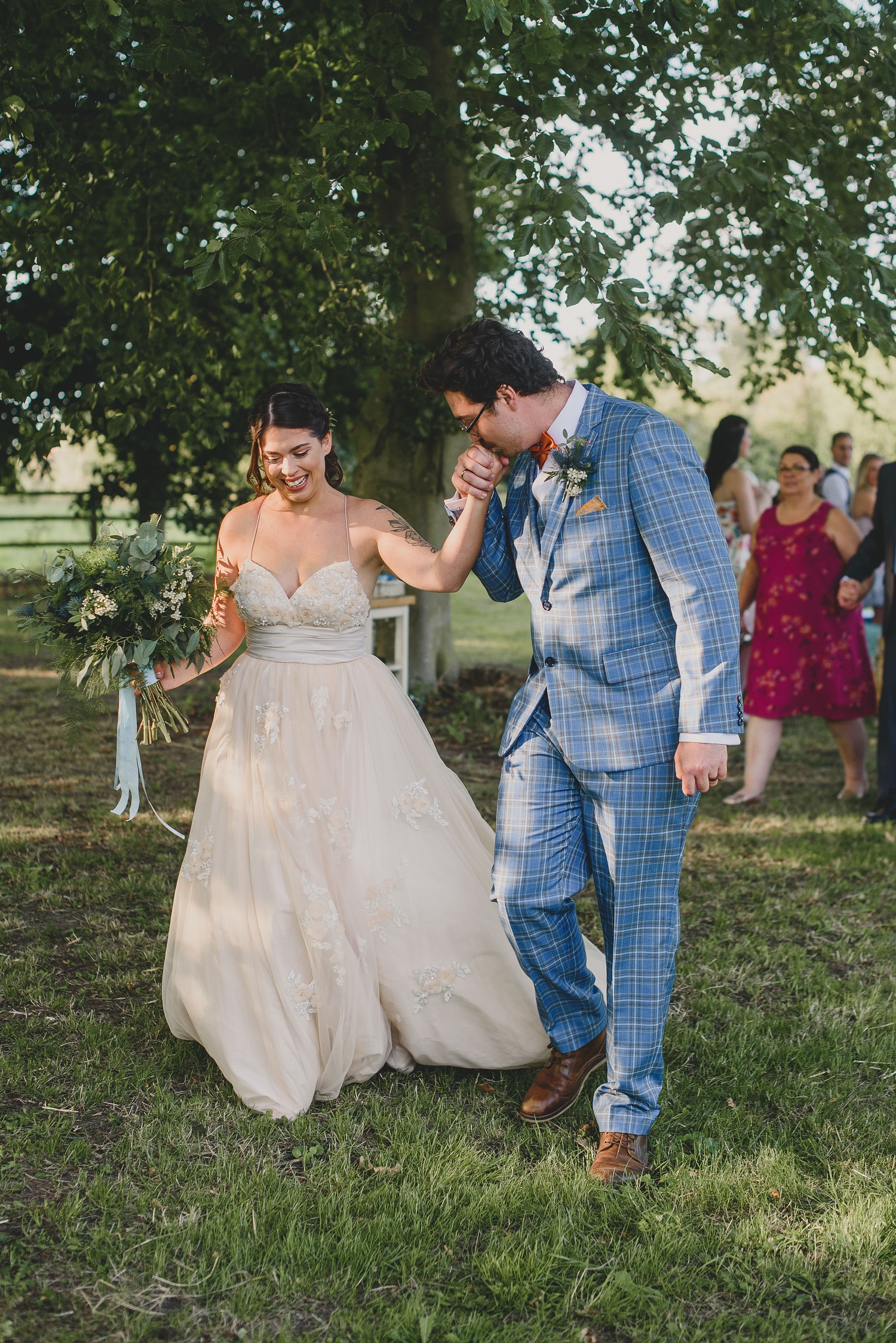 couple walking down aisle at college farm