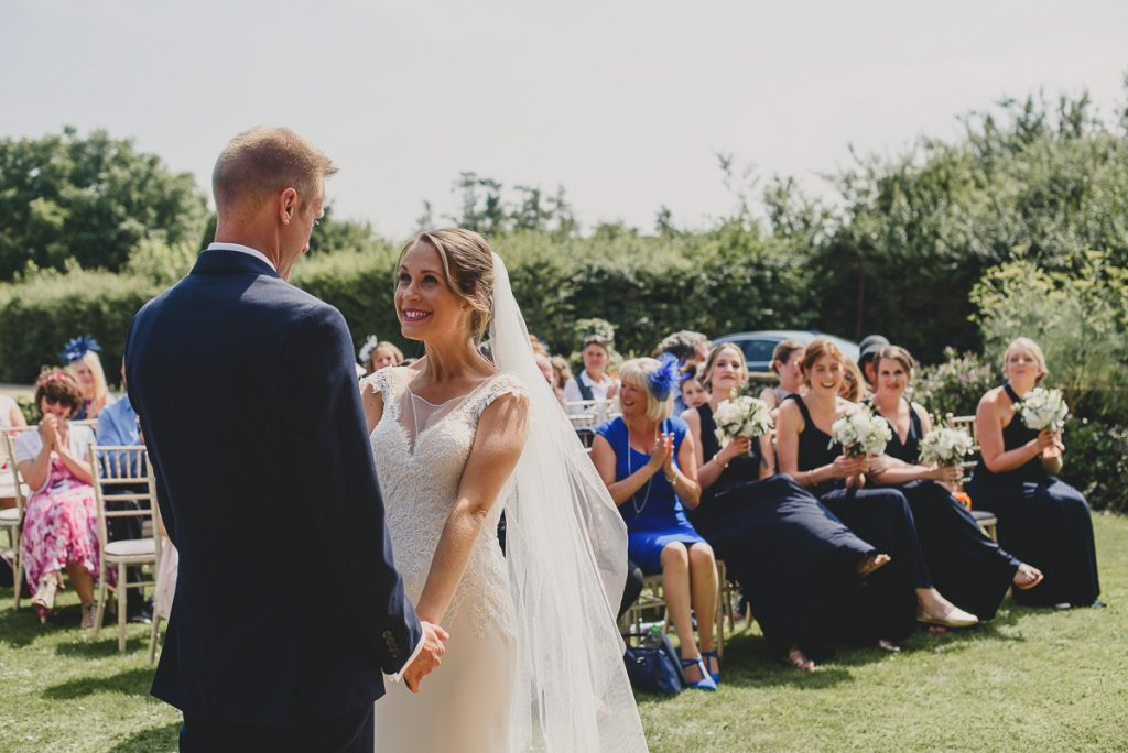 bride excited to see her groom at ceremony