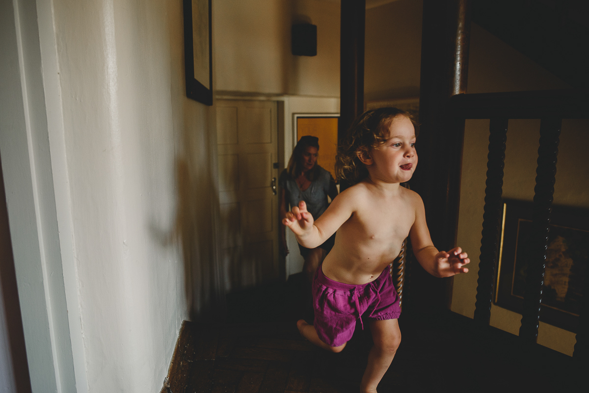 child running through corridors at voewood