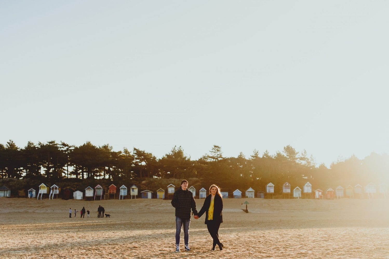 couple holding hands at wells beach